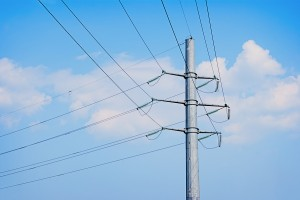 bigstock-Electric-Wires-Pole-On-A-Backg-46270987