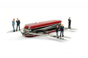 bigstock-Business-People-On-Penknife-5513157