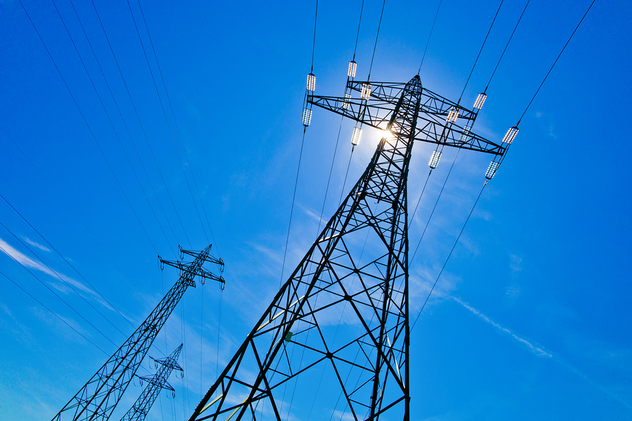 a power mast of a high voltage transmission line against blue sk